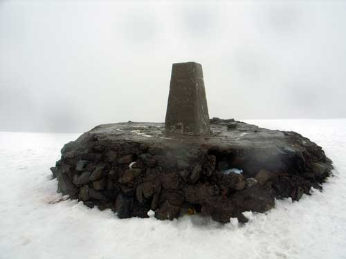 Summit cairn with trig point